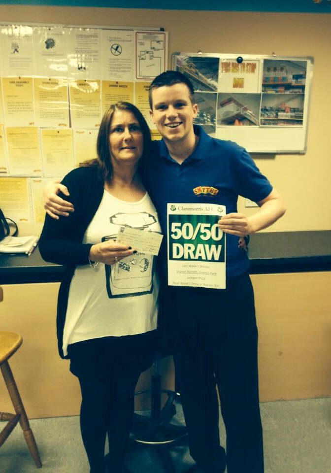 Last Saturday's 50/50 winner Sharon Barrett receiving her cheque of €516 from ticket seller Paddy Burke