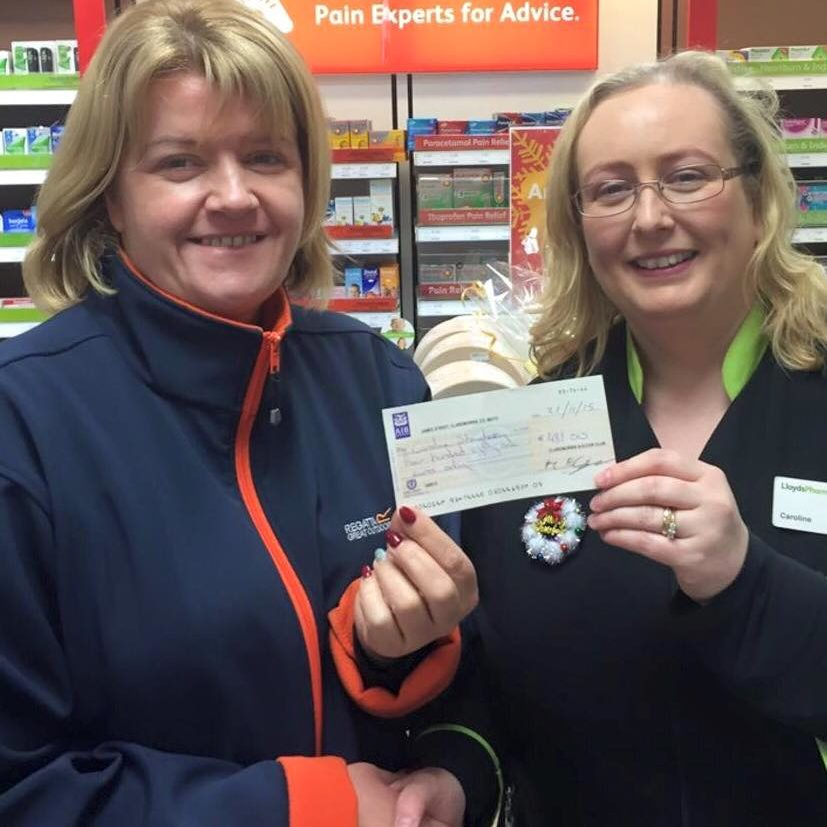 Caroline Shaughnessy being presented with her 50/50 cheque of €481 by Louise Murphy