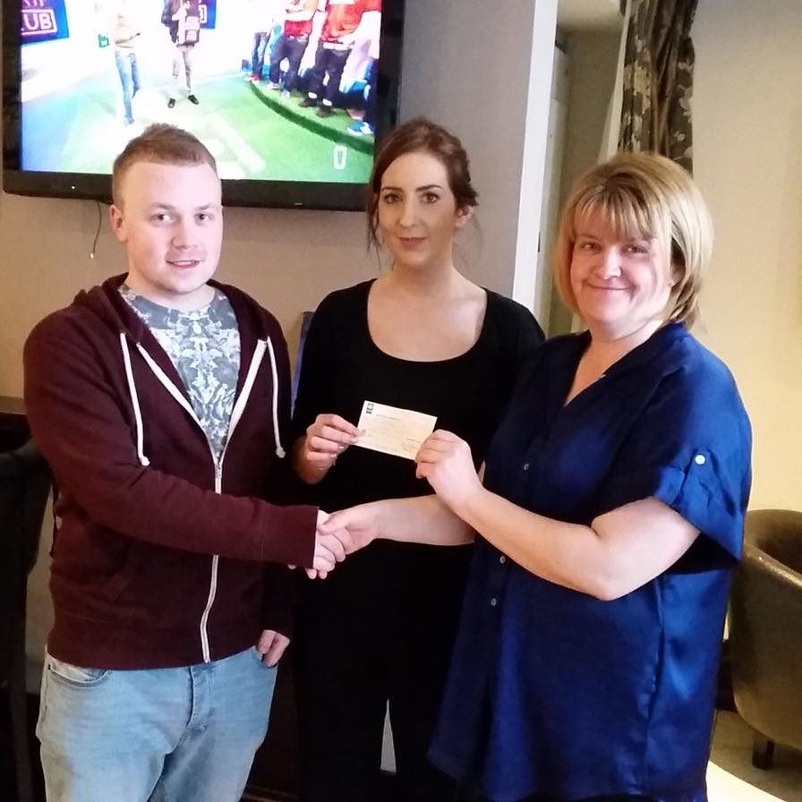 Claire Cunningham and Harry Grogan receiving their cheque of €544.