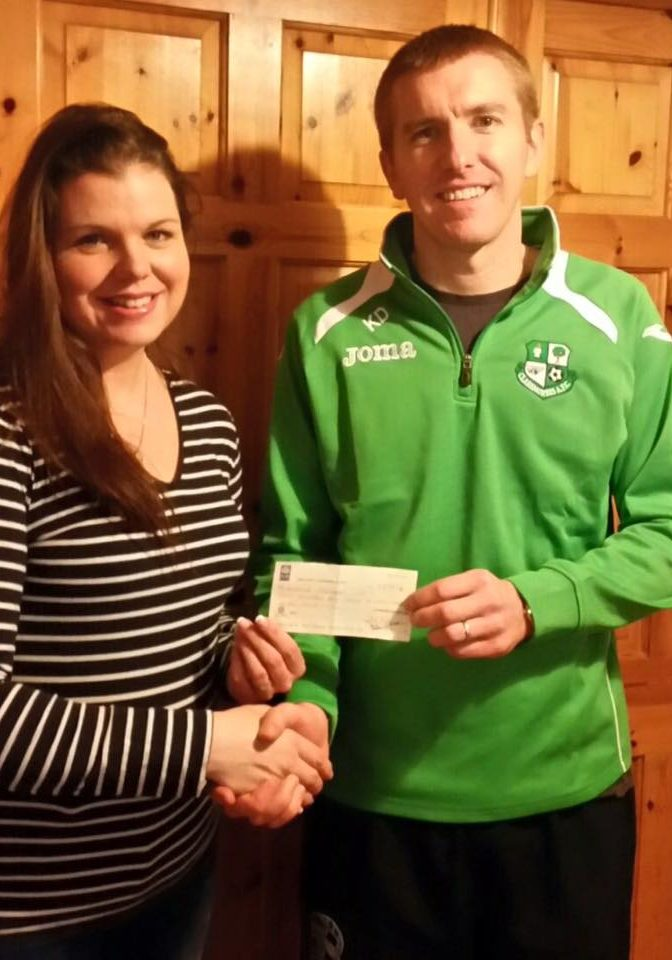 Martha Gaughan being presented with her 50/50 cheque of €440 by Kevin Duggan.