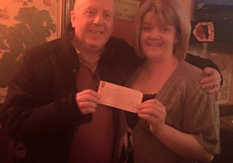 Winner of last weeks 50/50 Laurence Carey receiving his cheque for €555.
