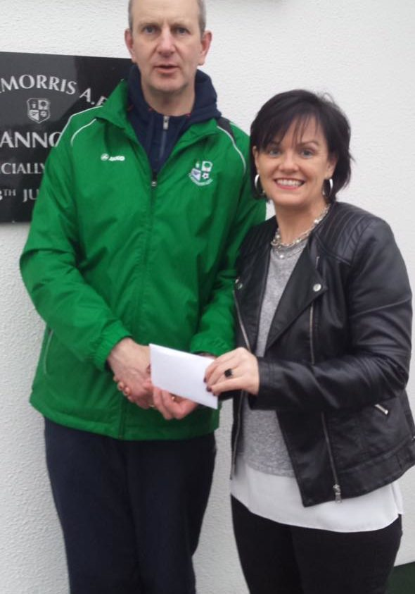 50/50 draw is Carmel Donnellan pictured receiving her cheque of €537 from Tom O'Dea.