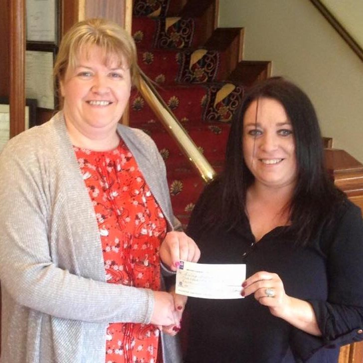 50/50 draw winner Aisling Hughes being presented with her cheque for €550 by Louise Murphy